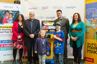 Anna Ahrens of Mary Bridge Children's Hospital, Don James of Nintendo of America and Adam Garone of Starlight Children's Foundation unveil the Starlight Nintendo Switch gaming station at Mary Bridge Children's Hospital in Tacoma, Washington. Photo credit: AJ Thompson/Nintendo of America